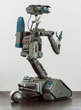 "Miniature Johnny Five prop from ""Short Circuit 2""."